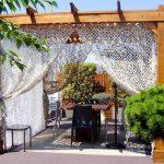 Comment décorer facilement sa terrasse avec un filet de camouflage